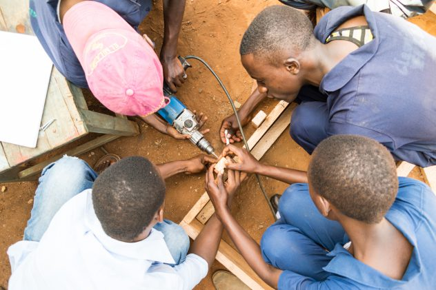 Many hands help building the wooden frame